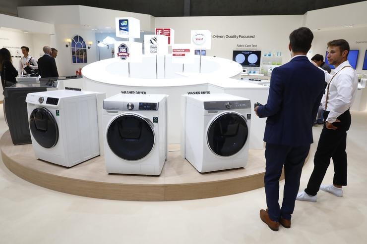Visitors look at the Samsung Home appliance Washing Machines at the 2018 IFA consumer electronics and home appliances trade fair during the fair's press day on August 30, 2018 in Berlin, Germany