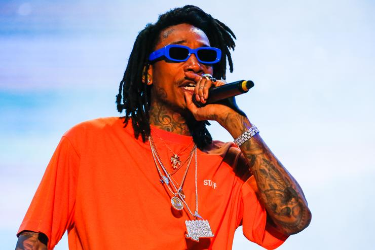 Wiz Khalifa performing with a joint