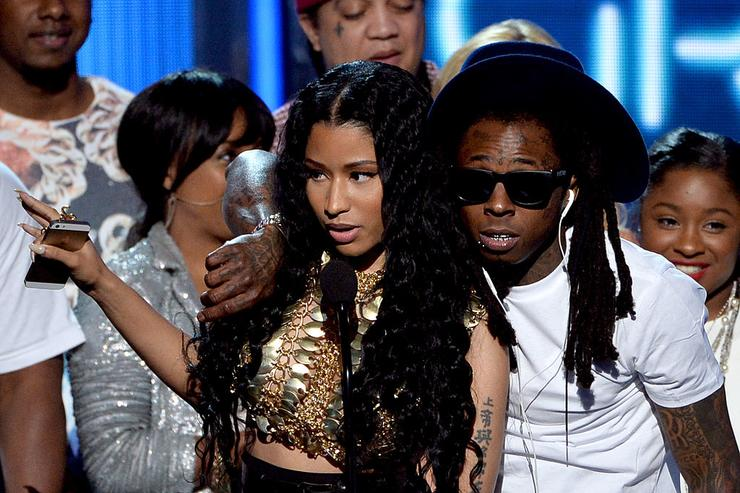 Nicki Minaj (L) and rapper Lil Wayne of Young Money accept Best Group onstage during the BET AWARDS '14 at Nokia Theatre L.A. LIVE on June 29, 2014 in Los Angeles, California.